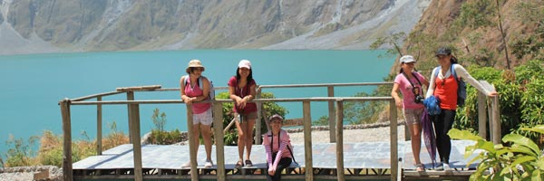 Women posing on the Pinatubo creater